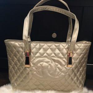 Chanel gold shopping bag